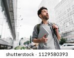 young tourist traveler with... | Shutterstock . vector #1129580393