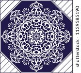 stencil mandala. blue and white ... | Shutterstock .eps vector #1129585190