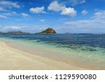 clear white sand beach with... | Shutterstock . vector #1129590080
