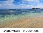 sumbawa island beach with rocks ... | Shutterstock . vector #1129590083