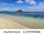 beautiful clear beach with... | Shutterstock . vector #1129590086
