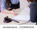 injured employee visiting... | Shutterstock . vector #1129604153