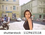 merry brunette woman with... | Shutterstock . vector #1129615118