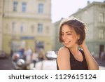 cheerful brunette woman with... | Shutterstock . vector #1129615124