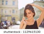 happy brunette woman with... | Shutterstock . vector #1129615130
