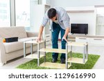 man assembling furniture at home | Shutterstock . vector #1129616990