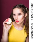 fashionable brunette woman with ... | Shutterstock . vector #1129619630