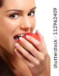 Young Brunette Woman Eating An...