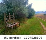 unique handcrafted bench on the ... | Shutterstock . vector #1129628906