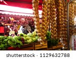 strings of garlic and... | Shutterstock . vector #1129632788