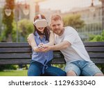 a young couple plays a game... | Shutterstock . vector #1129633040
