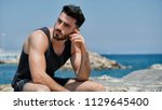 attractive fit athletic young... | Shutterstock . vector #1129645400