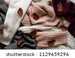background with warm sweaters.... | Shutterstock . vector #1129659296