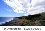 black beach on maui hawaii road ... | Shutterstock . vector #1129664393