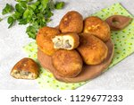 delicious fried patties with... | Shutterstock . vector #1129677233