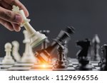 the king in battle chess game... | Shutterstock . vector #1129696556