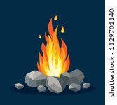 bonfire with stone  rock... | Shutterstock .eps vector #1129701140