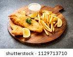 fish and chips with french... | Shutterstock . vector #1129713710