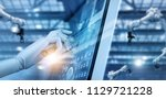 hand robot working on control... | Shutterstock . vector #1129721228