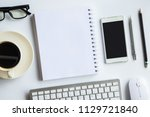white desk office with laptop ... | Shutterstock . vector #1129721840