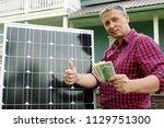 Solar Panel. Money In The Hands ...