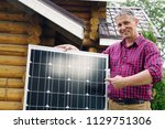 Solar Panels In The Hands Of...
