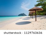 beautiful tropical island white ... | Shutterstock . vector #1129763636