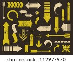 a set of old scratched arrows. | Shutterstock . vector #112977970