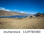 a solar power station under... | Shutterstock . vector #1129783580