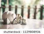 white piggy bank and coin on... | Shutterstock . vector #1129808936