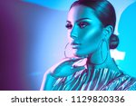 high fashion model woman in... | Shutterstock . vector #1129820336