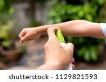 father spraying insect... | Shutterstock . vector #1129821593