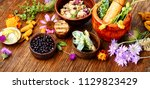 raw medical herbs and flowers... | Shutterstock . vector #1129823429