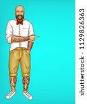vector pop art excited tattooed ... | Shutterstock .eps vector #1129826363