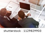 business colleagues discussing... | Shutterstock . vector #1129829903