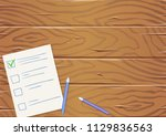 wooden table with paper list... | Shutterstock .eps vector #1129836563