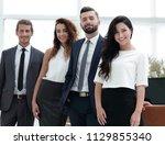 successful business team in... | Shutterstock . vector #1129855340