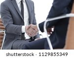 wo focused coworkers sitting... | Shutterstock . vector #1129855349