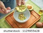 young woman making nourishing... | Shutterstock . vector #1129855628