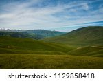 pass in the almaty mountains ... | Shutterstock . vector #1129858418