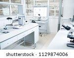 interior of modern science... | Shutterstock . vector #1129874006