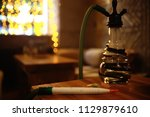 hookah in the restaurant  ... | Shutterstock . vector #1129879610