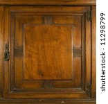 An antique cupboard door with brass keylock and hinges - stock photo