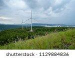 wind turbines on the mountain.   Shutterstock . vector #1129884836