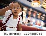 asian girls eat ice cream...   Shutterstock . vector #1129885763