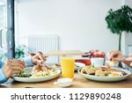 close up of two people having... | Shutterstock . vector #1129890248