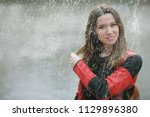 rainy weather girl posing fall  ... | Shutterstock . vector #1129896380