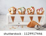 ice cream in cone with... | Shutterstock . vector #1129917446
