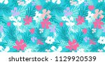 blooming exotic flowers and... | Shutterstock . vector #1129920539