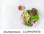 salad with chicken breast with... | Shutterstock . vector #1129929470